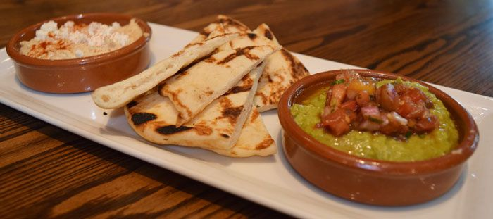 Hummus & Field Pea Dips with crumbled feta, Turkish ezme and sesame seeds, served with grilled pita//Green Valley Grill// Greensboro,NC