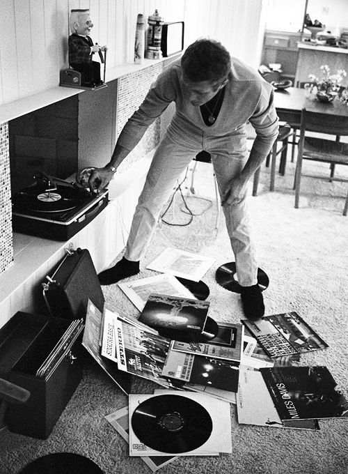 Steve McQueen playing records at home, 1963. Photo John Dominis