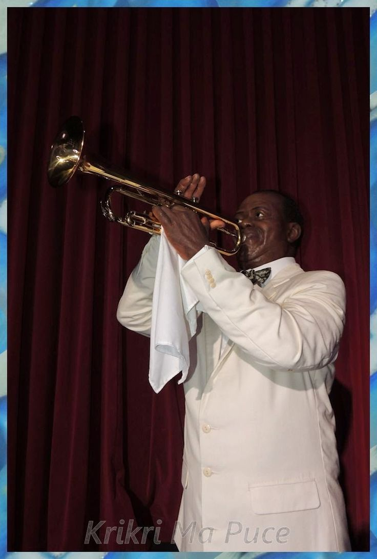 Louis Armstrong http://evasionqc.blogspot.ca/2014/03/a-vos-marques-grevin2.html