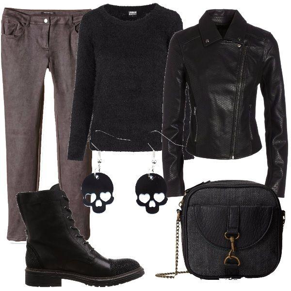 Abbigliamento comodo per un'anima rock. La giacca da donna nera, in ecopelle fa da padrona in questo abbinamento. Scegliamo, poi, un paio di pantaloni grigi, un pullover totalmente nero, un paio di stivaletti neri, con piccole borchie, una borsa in tela ed ecopelle e un paio di orecchini neri a forma di teschio.