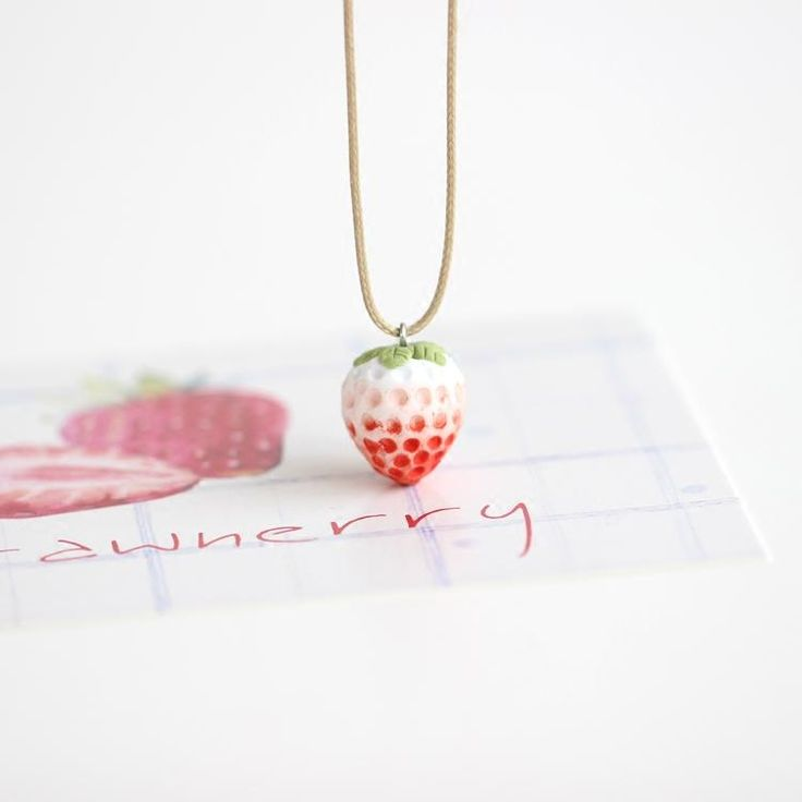 Ceramic Strawberry Necklace - 100% Handmade and Hand painted Ceramic Jewelry. This delicate little Pendant and Necklace will look good no matter what you are wearing, and go with any Occasion! #kawaii