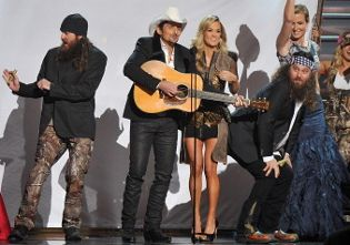 "Here is a GIF of ""Duck Dynasty"" star Willie Robertson twerking on Carrie Underwood at the 2013 CMA Awards. You're welcome."