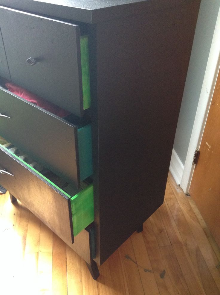 Repainted old dresser! Black exterior and bright colours inside drawers:)