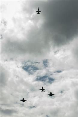 """U.S. Navy F/A-18 jets from Strike Fighter Squadron (VFA) 106 and Strike Fighter Squadron (VFA) 34, from Naval Air Station Oceana (Va.) fly in a """"Missing Man"""" formation over the Camargo Club following a private memorial service celebrating the life of Neil Armstrong at the Camargo Club in Cincinnati, OH in this August 31, 2012 NASA handout photo. Armstrong, the first man to walk on the moon during the 1969 Apollo 11 mission, died August 25. He was 82.REUTERS/NASA/Bill Ingalls/Handout"""