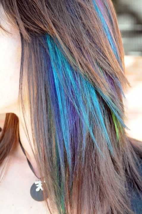 I love the slight infusion of bright hair color with her natural hair. I would do this.