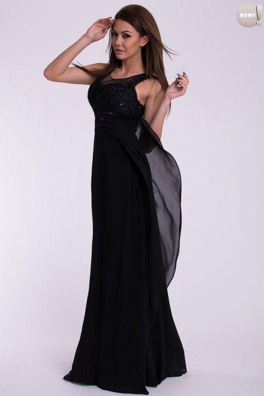 Elegancka, czarna, długa suknia ozdobiona haftem i cekinami. #suknia #sukienka #elegancka #czerń #długa #kobieta #moda #trendy