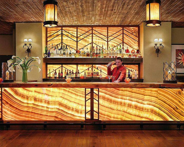 what we do for the back wall of the bar we may do on the kick area under the front of the bar- tile or stone. Light them both well
