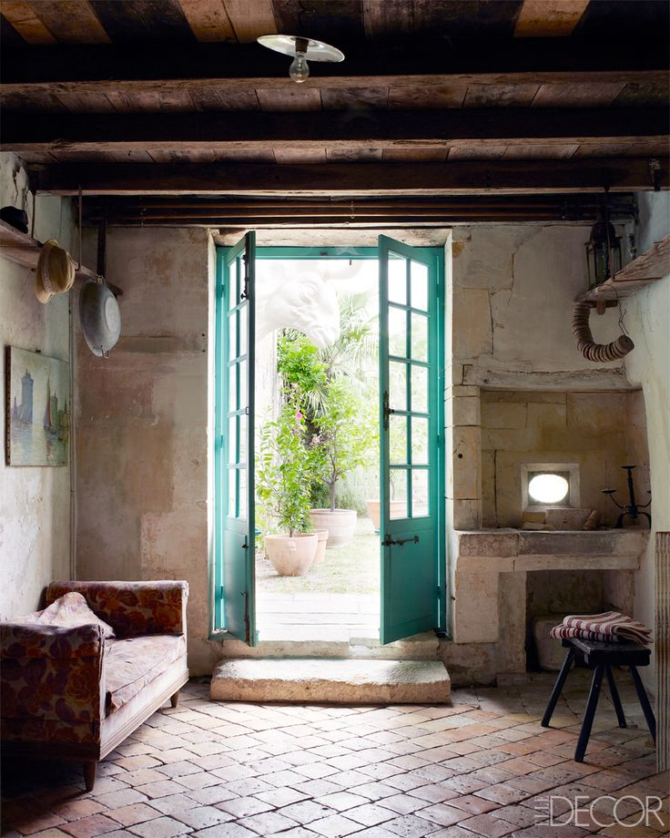 Mathilde Labrouche Home in Southwestern France - 18th Century French Farmhouse - ELLE DECOR... Beautiful. Love the pop of color from the door