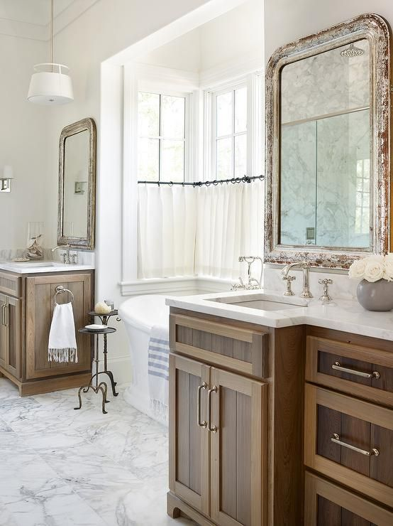 Gorgeous well appointed bathroom features his and her separate stained oak washstands accented for How to stain a bathroom vanity