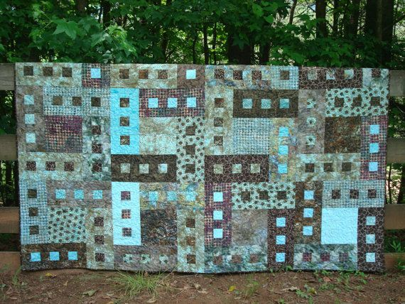 Here is a aqua, teal and brown twin bed quilt. The colors on this quilt go from a light aqua to teal, and taupe to a rich dark brown. Its a gorgeous quilt. I machine pieced and machine quilted it. The quilting is done in a aqua thread, using a meandering pattern. For the back I used a teal colored fabric, as seen in the picture. For the binding I used dark brown batik, that is also in the quilt.  The measurements are 61 x 80. This will fit over a twin bed, day bed or be an extra large throw…