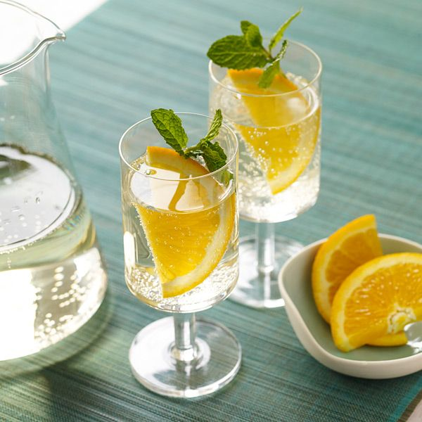 White Wine Coolers - These coolers are a fun, festive drink for any warm-weather gathering. Feel free to vary the flavor with different types of sugar-free soda and fruit! 3 SmartPoints
