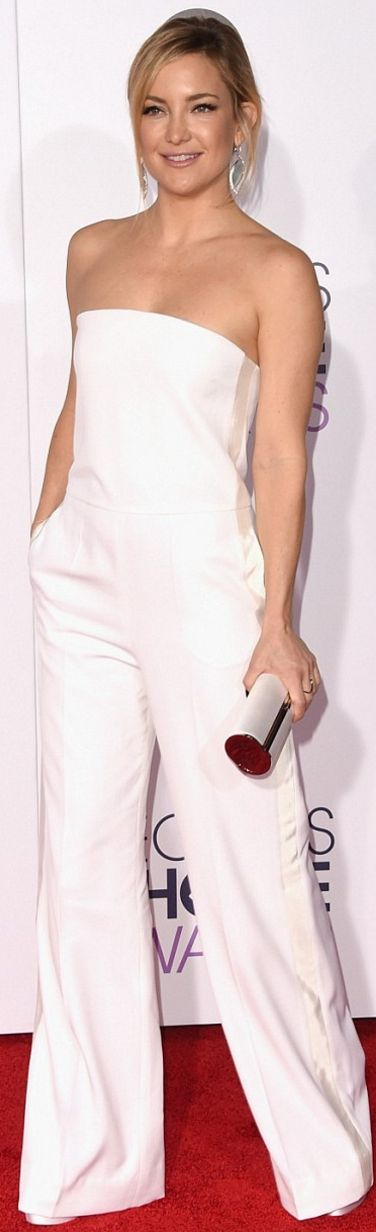 Kate Hudson: Jumpsuit – Stella McCartney  Shoes – Brian Atwood  Earrings -Jorge Adeler  Purse – Jimmy Choo