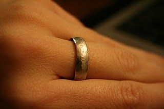 How to make a ring out of a quarter.  You read right. $0.25. DIY tutorial... I want to do this with one of the Euros Tim and I got on our honeymoon!