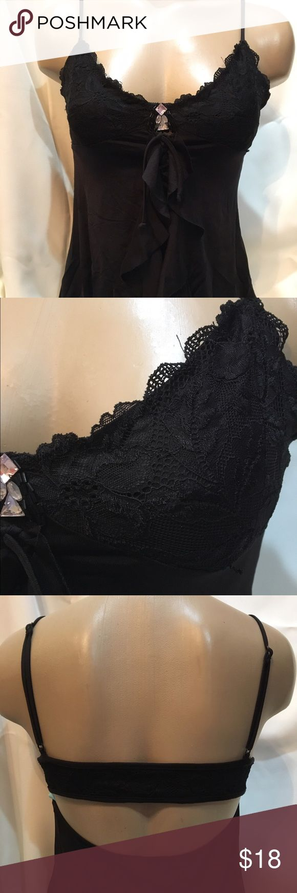 "Guess Marciano Black Top M 92% nylon 8% spandex 						Adjustable shoulder straps 					Rear center elastic lace covered back band Gathered front center ruffle 				Rhinestone & Sequin sewn on bodice accents 	  34"" chest unstretched 							  24"" length Guess by Marciano Tops Camisoles"