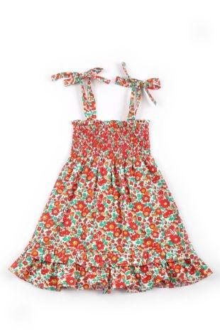 Vestido para niña, tipo strapless y con tiritas sobre los hombros hecho en tela estampada con flores rojas con amarillo y verde.