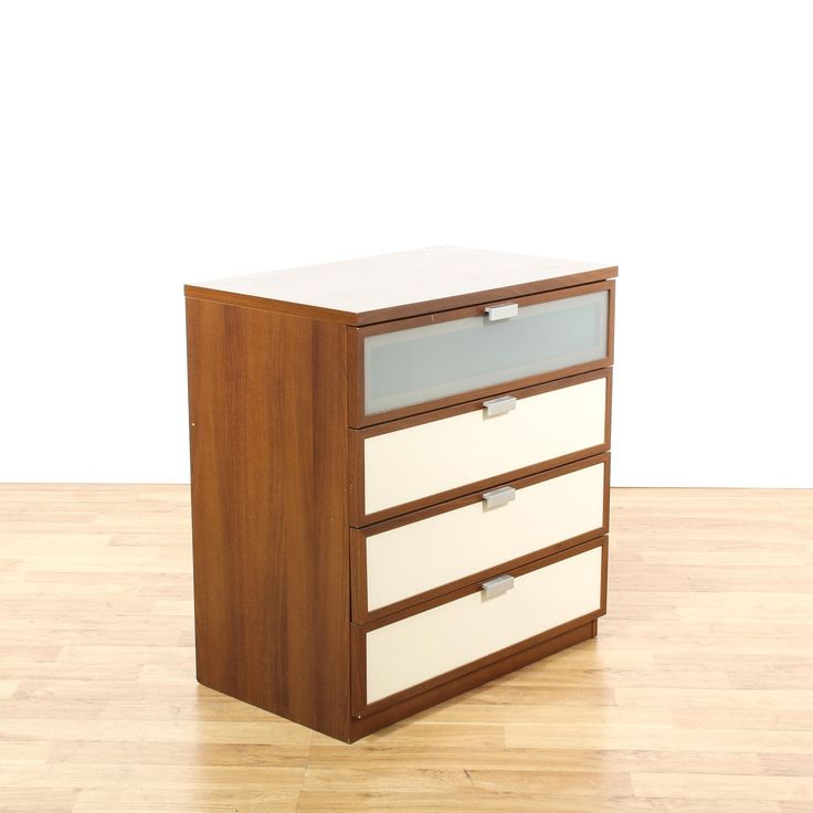 This contemporary chest of drawers is featured in a wood with a medium walnut finish. This short dresser has 4 drawers, metal pulls and white front panels. Minimalist storage piece perfect for a modern space! #contemporary #dressers #chestofdrawers #sandiegovintage #vintagefurniture