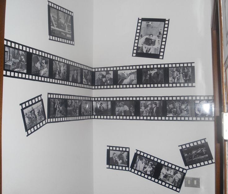 come dare personalità ad un piccolo e buio corridoio....un po di pellicola adesiva e stampe dei vecchi film di bambina