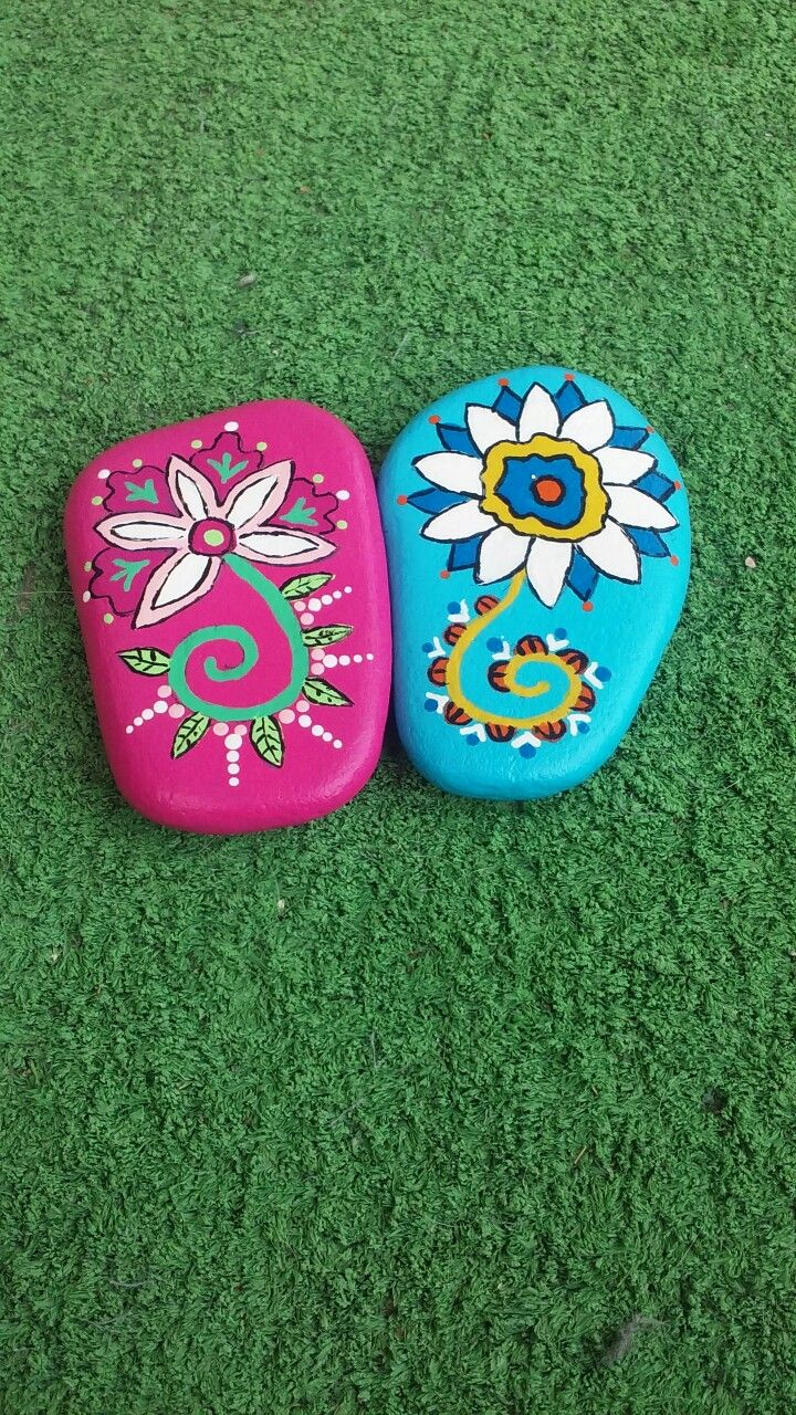 Flowers painted on Lake Huron beach stone's by Cindy P 2017