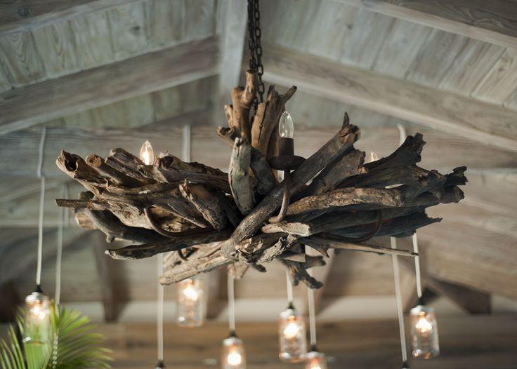 Driftwood chandelier in beach cabana. Home design by Novogratz.