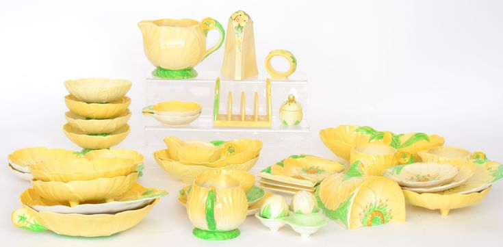 A collection of assorted embossed Carlton Ware decorated with yellow buttercups to include dishes