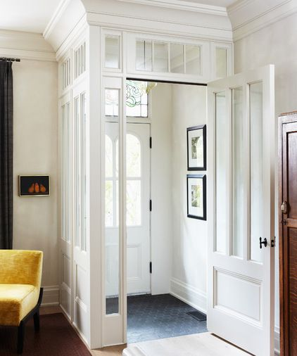 old windows used to frame around the front door - pretty idea to create a front entry