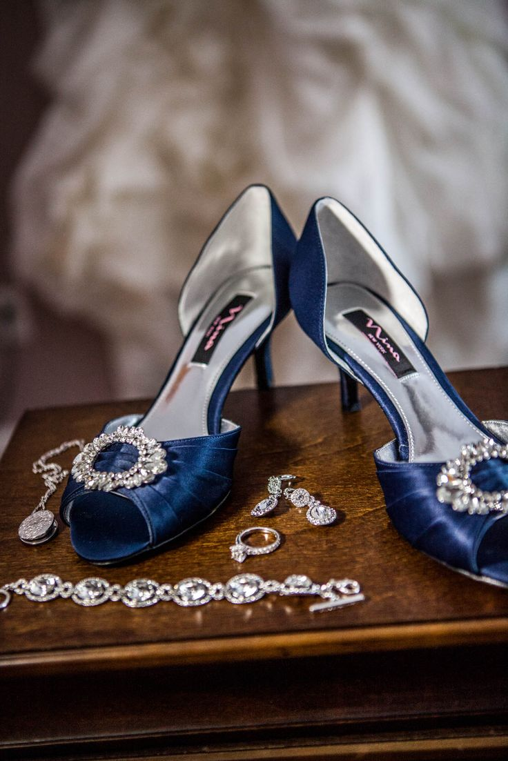 Sparkling jewelry wedding rings a white dress and cute blue shoes