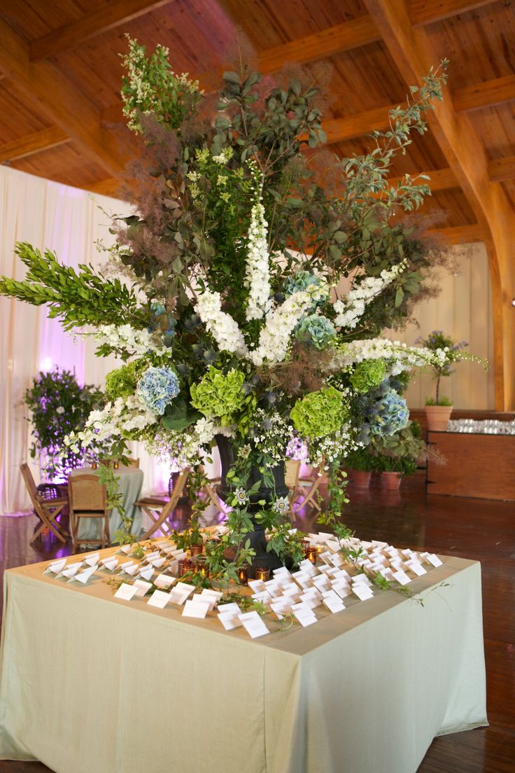 A magnificent display summer flowers and branches for this escort card table