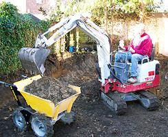 Power Barrow The four wheel drive muck truck is a power barrow for moving all kinds of building and landscaping materials over almost any terrain, effortlessly! It has also become very popular with tree surgeons and woodland owners for extracting logs and timber. The standard machine muck truck is just 714mm wide making it easy to manoeuvre through garden side gates and narrow access areas.