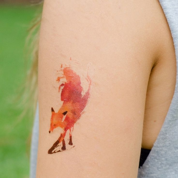 watercolor fox tattoo meaning on the arm for girls