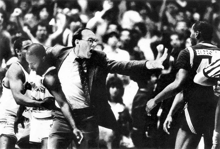 Syracuse basketball coach Jim Boeheim shields his star guard, Dwayne Washington, from harm during a fight between Syracuse and Georgetown players at Madison Square Garden March 7, 1986. Greg Monroe is pictured on the far left; Georgetown's Ronnie Highsmith is on the right. Washington scored 21 points and helped Syracuse to a 75-73 victory, securing a berth in the finals of the Big East Conference Tournament. The Post-Standard file photo