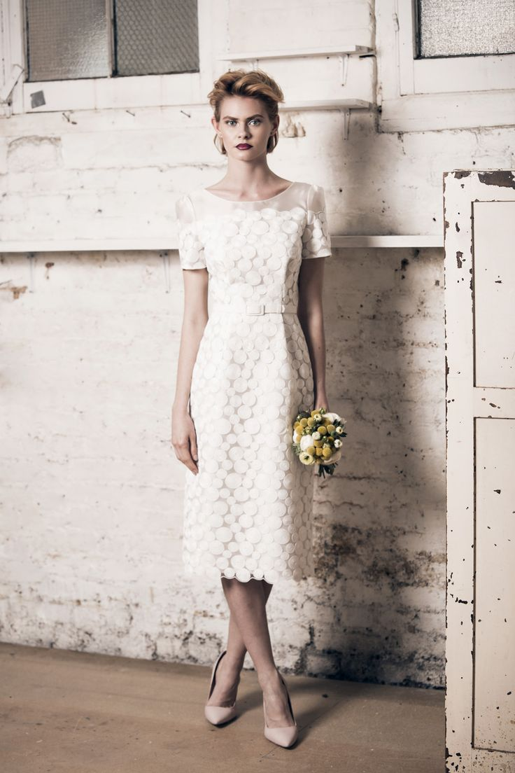 Modern wedding dress for the contemporary bride. Emily dress. Circle embroidery net dress with scallop detail.