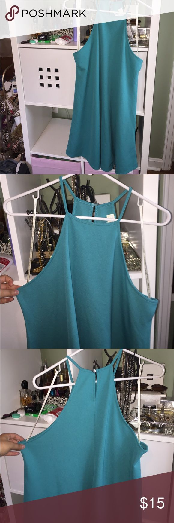 Brand NWT turquoise sleeveless dress NWT, pictures don't do this color justice! Gorgeous aquamarine/turquoise shade of blue. Flattering fit. Selling for a friend, who bought this for an event and never wore it, if it were my size I would keep it! Gorgeous piece, can be dressed up with jewelry. Not Lily Dresses
