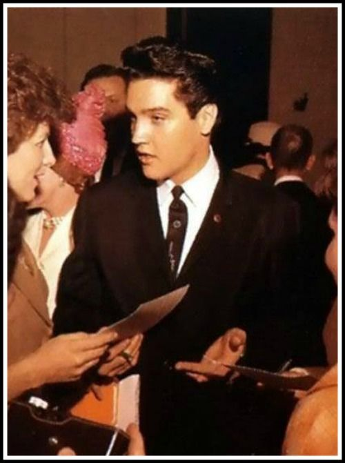 Elvis signs autographs after completing the press conference held in Memphis, Tennessee, on February 25, 1961 (to honor Elvis for his numerous contributions to local charities)
