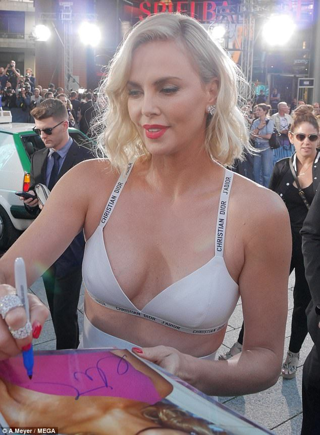 Busty: Charlize Theron, 41, showed she isn't afraid of rocking a daring look in real life as she wowed at the world premiere of her new film Atomic Blonde in Berlin, Germany on Monday