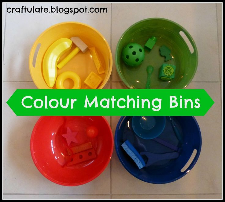 This idea came after we played some Bean Bag Games - once I had four containers of different colours, it was just a matter of finding some matching contents.        I pulled together an assortment of items for the bins: block, ball, spoon, sponge, pipe cleaner, harmonica - anything that was almost entirely one colour.   First of all I showed them to F with the items in the correct colour bin. Then I made a pile  out of all them in the middle, and let him put them in the corr