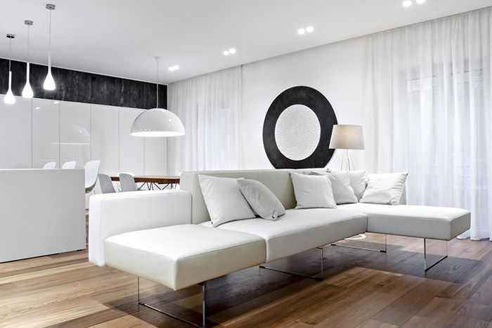 Modern living room design idea with beautiful white sofa in a renovated apartment located in Italy