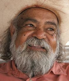 """Bob Randall is a Yankunytjatjara Elder and a traditional owner of Uluru (Ayers Rock). Bob is one of the Stolen Generation of the Aboriginal people, taken from his family at the age of seven. Throughout his life, Bob has worked as a teacher and leader for Aboriginal land rights, education, community development and cultural awareness. In the early '70s, Bob's song """"Brown Skin Baby (They Took Me Away)"""" became an anthem for the Aboriginal people."""