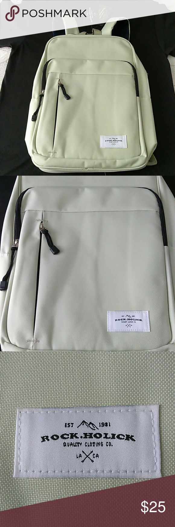 New Rock Holick Backpack New Rock Holick Backpack. Padded laptop sleeve. Super sleek, classic style. A subtle mint-greenish grayish color with black zipper detailing. Such a classy backpack! Rock.Holick Bags