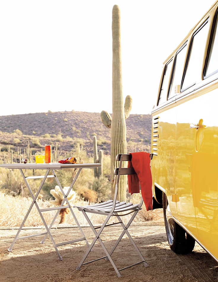 Camp out in modern.  Arc En Ciel Folding Table Designed by EMU Design Studio Styled by Studio Marcus Hay