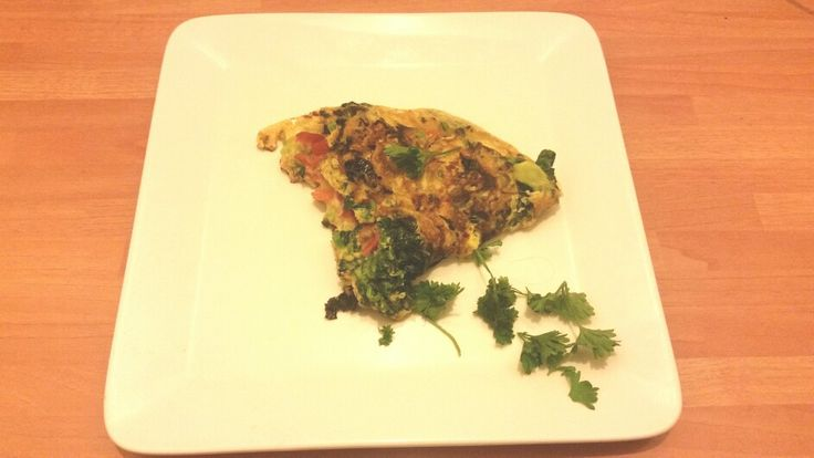 Frittata. ..kale, tatsoi,  tomatos,  parsley,  eggs