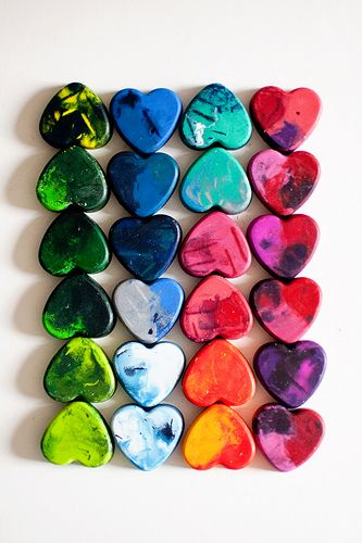 "A boy in my class a couple years ago gave these as little Valentines made out of melted crayons.  He said, ""For Crayon Out Loud, Happy Valentine's Day""... could also say, ""You COLOR my world!""  Use silicone cups to melt them in."