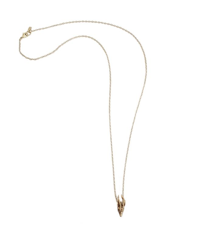 Layer this ram skull pendant necklace for a rock 'n' roll vibe. Made from recycled brass and plated in 14k antique gold.