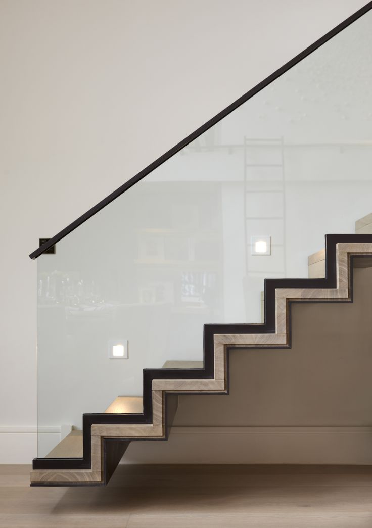floating staircase | black trim | staircase lighting | contemporary design | light hardwood floors