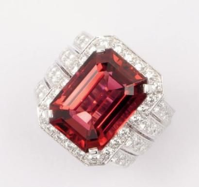 CARTIER Platinum ring set with a wide rectangular rubellite in a circle of brilliant-cut diamonds bordered by eight rows of diamonds. Rube ...
