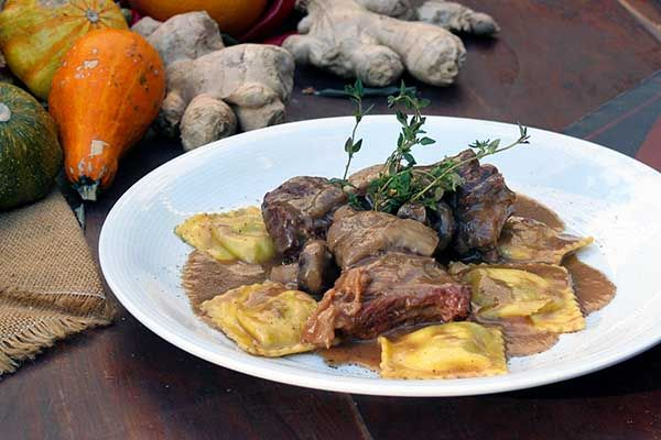 Beef stew in a pot with a variety of mushrooms, garnished with tortellacci stuffed with ricotta and spinach.Paparouna Wine Restaurant & Cocktail Bar   OUR CHRISTMAS DISHES!!!
