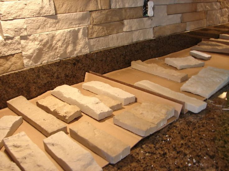 DIY Stone Backsplash with AirStone --- I actually did this too!!! Used the two different colors to mix tans and grays to match my counter!!!
