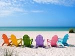 colorful adirondacks on the beach