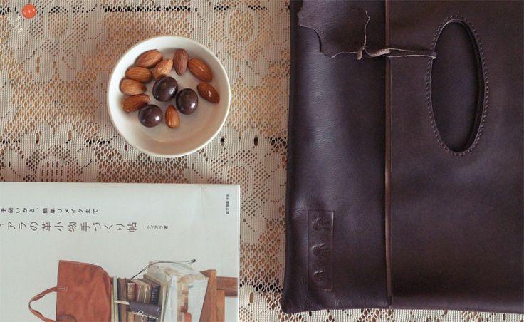 LINDT - Leather Clutch  http://www.facebook.com/media/set/?set=a.367503619998435.84866.100002163997275=3