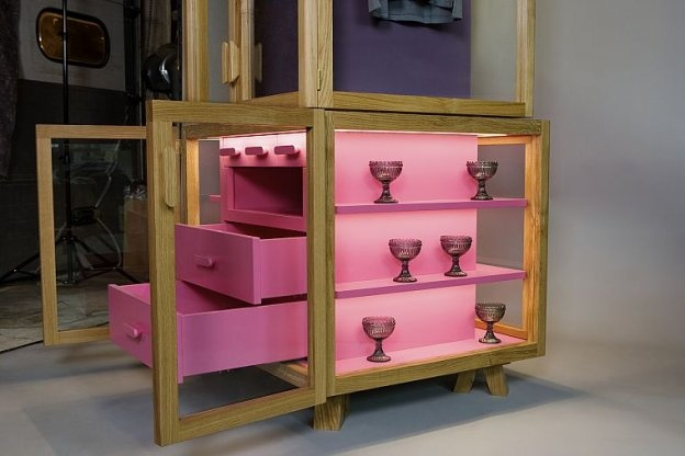 Ropero wardrobe system, traditional glass cabinets filled with brightly coloured modules. Very cute. By Hierve.