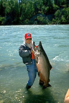 fisherman with his catch ~ King Salmon, Kenai Peninsula, Alaska